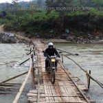 Dirt biking Northern Vietnam. Bamboo bridge is used when the water is low. This is only possible on a motorbike trip